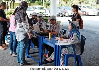 SUBANG JAYA, MALAYSIA - MAY 9, 2018: Election officers at a registration polling station in Subang Jaya, Malaysia. Malaysians are participating in the 14th Malaysian general election.