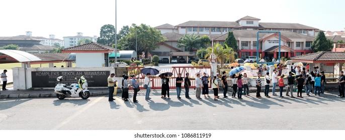 SUBANG JAYA, MALAYSIA - MAY 9, 2018: Voters queue at a polling station in Subang Jaya, Malaysia. Malaysians are participating in the 14th Malaysian general election.