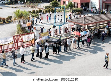 SUBANG JAYA, MALAYSIA - MAY 9, 2018: Voters queue at a polling station in Subang Jaya, Malaysia. Malaysians are participating in the 14th Malaysian general election.