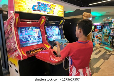 Subang, Malaysia - 20/8/2018 : Unidentified people having great time playing games at the Family Games and Amusement Arcade at Subang Parade