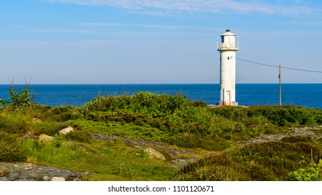 The Subbe lighthouse in southern Varberg, Sweden, with surrounding landscape on a sunny and calm morning.