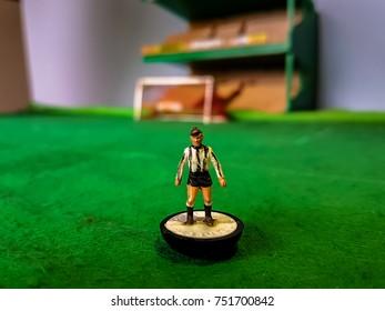 Subbuteo football figure lined up on a grass football field, Newcastle Utd, Juventus