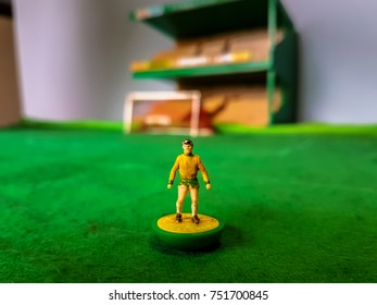 Subbuteo football figure lined up on a grass football field, Norwich City