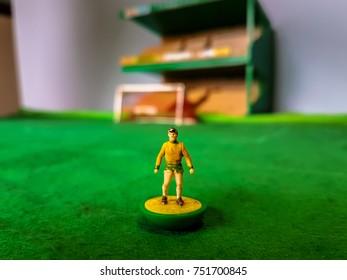 Subbuteo football figure lined up on a grass football field, Norwich City