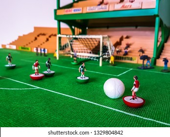 Subbuteo football figures in action in front of the goal on a grass field, Arsenal v Liverpool
