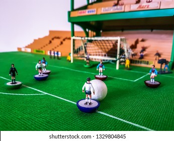 Subbuteo football figures in action in front of the goal on a grass field, Tottenham v West Ham