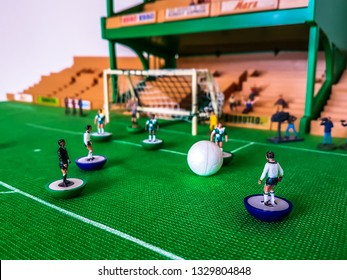 Subbuteo football figures in action in front of the goal on a grass field, Tottenham v Liverpool