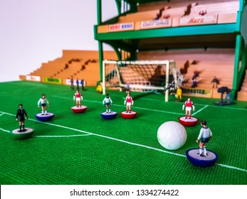 Subbuteo football figures in action in front of the goal on a grass field, Tottenham v Arsenal