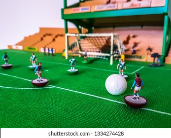 Subbuteo football figures in action in front of the goal on a grass field, West Ham v Liverpool