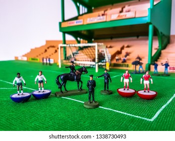 Subbuteo football figures in action in front of the goal on a grass field, Arsenal v Tottenham Hotspur