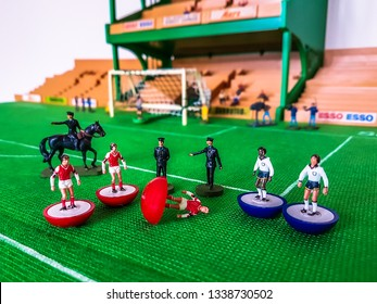 Subbuteo football figures in action in front of the goal on a grass field, Arsenal v Tottenham with police horses