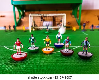 Subbuteo football figures in action in front of the goal on a grass field, Arsenal, Liverpool, Tottenham, Newcastle, West Ham, and Wolves