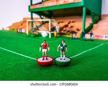 Subbuteo football figures in action in front of the goal on a grass field, Liverpool v Arsenal