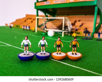 Subbuteo football figures in action in front of the goal on a grass field, Tottenham v Wolves