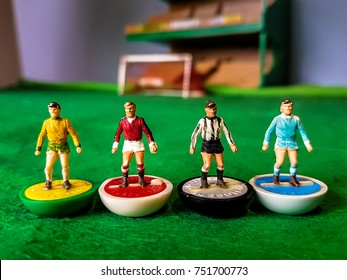 Subbuteo football figures in action on a grass football field