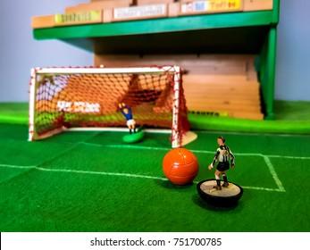 Subbuteo football figures in action on a grass football field, Newcastle Utd