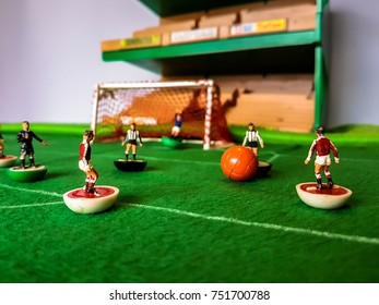 Subbuteo football figures in action on a grass football field, Manchester Utd vs Newcastle Utd