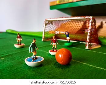 Subbuteo football figures in action on a grass football field, Manchester Utd vs Manchester City
