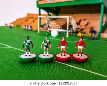 Subbuteo football figures lined up in front of the goal on a grass field, Liverpool v Manchester United