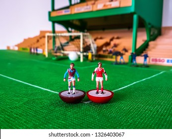 Subbuteo football figures lined up in front of the goal on a grass field, West Ham v Arsenal