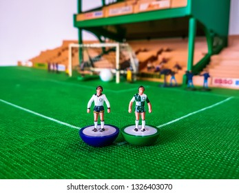 Subbuteo football figures lined up in front of the goal on a grass field, Tottenham v Liverpool Champions League Final