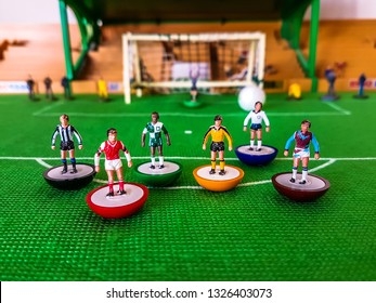 Subbuteo football figures lined up in front of the goal on a grass field, Newcastle, Arsenal, Liverpool, Wolves, Tottenham, West Ham