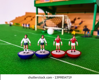 Subbuteo football figures lined up in front of the goal on a grass field, Arsenal v Tottenham