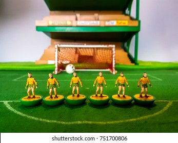 Subbuteo football figures lined up on a grass football field, Norwich City