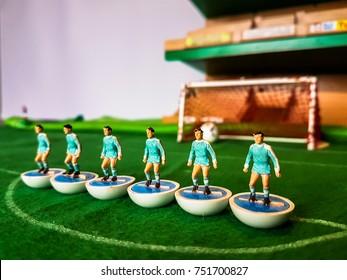 Subbuteo football figures lined up on a grass football field, Manchester City