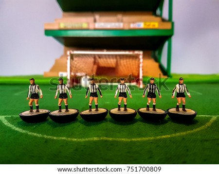 Subbuteo football figures lined