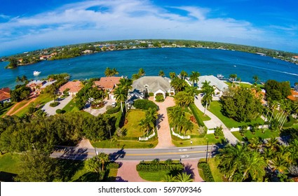 Subdivision in Florida located beside a lake Aerial skyline shot