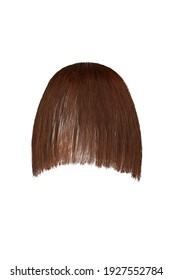 Subject shot of brown bangs with smooth edge. Natural looking tresses for hair extension are isolated on the white background.