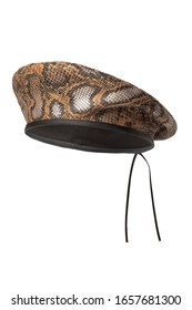 Subject shot of a brown and silver snakeskin beret with a black undercloth and back ties. The leather hat is isolated on the white background.