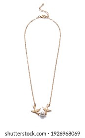 Subject shot of golden necklace with two golden swallows and pearl bead. The adjustable necklace with lobster clasp and extension chain is isolated on the white background.