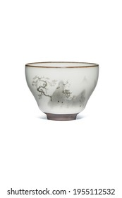 Subject shot of white ceramic bowl with crazing and decorated with gray landscape painted in Chinese style. Graceful tea bowl is isolated on the white background.