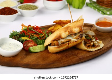 Submarine baguette chicken sandwich with melted cheese, vegetable and french fries