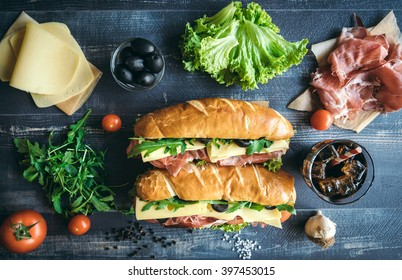 Submarine sandwiches served on the table from above,selective focus
