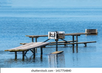 submerged picnic table on flooded lake