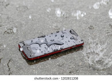 Submerged smart phone.