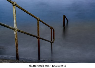 Submerged steps into the sea.