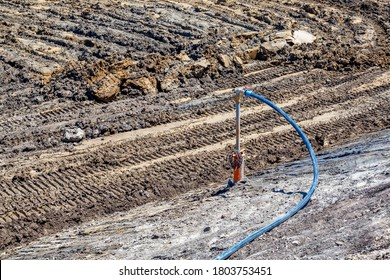 Submersible pump system dewater at construction site, pumping flood water using deep well.