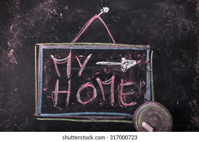 Submission of written home, with chalk on blackboard