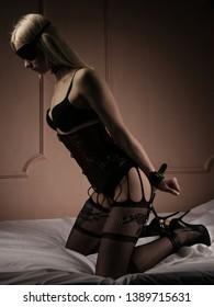 Submissive girl in bondage prepare for punishment. - Image
