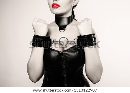 Submissive girl in leather