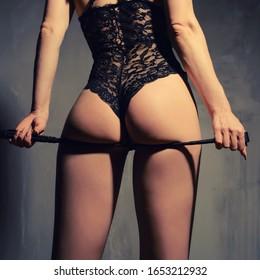 submissive girl waiting for punishment. spanking. bdsm theme.