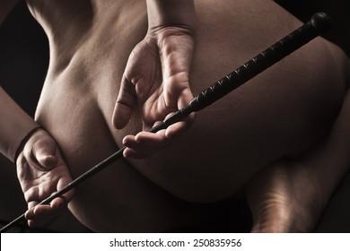 submissive girl waiting for punishment / spanking / bdsm theme