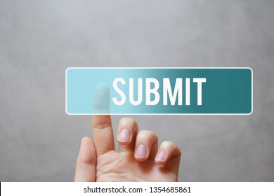 Submit - finger pressing blue transparent button on virtual touchscreen interface on gray background with copy space for text.