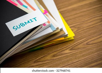 Submit; The Pile of Business Documents on the Desk