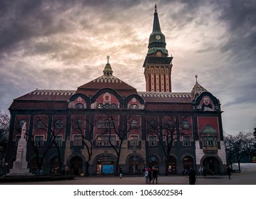 Subotica, Serbia, April 2018 - City Hall with monument at sunset in Subotica, Serbia