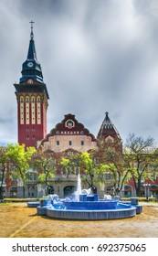 Subotica, Serbia - April 23, 2017:  Retro building of city hall in Subotica city and blue fountain, Serbia